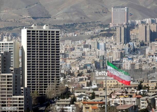 tehran urban skyline and iran flag - iranian flag stock photos and pictures