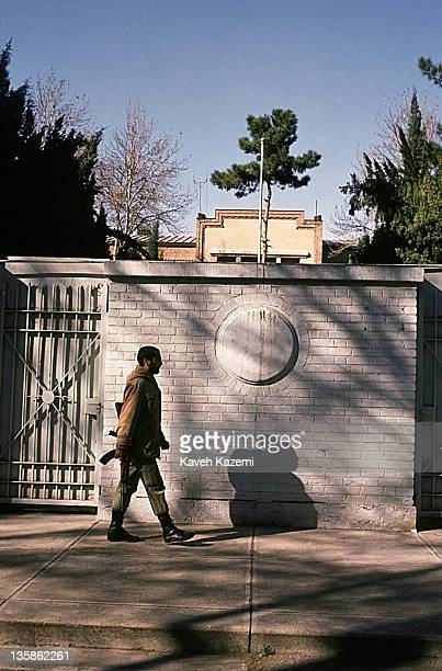 Revolutionary Guard passes by the spot where the emblem of the United States of America was engraved on the walls of the embassy, 4th November 1995....