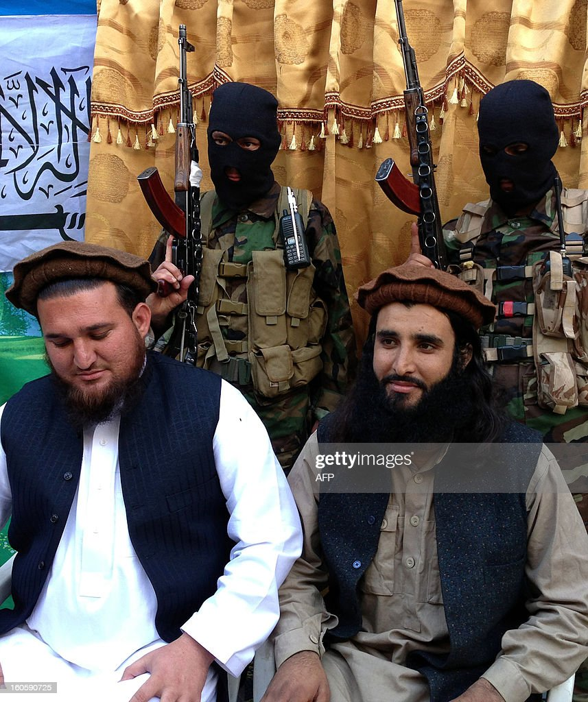 Tehreek-e-Taliban Pakistan (TTP) spokesman Ehsanullah Ehsan (L) and new TTP member Adnan Rasheed address a press conference in Shabtoi, a village in Pakistan's South Waziristan, on February 2, 2013. The Pakistani Taliban urged the Muslim world to unite in a video message released February 3 as they condemned the French military intervention in Mali as an 'ideological war'. AFP PHOTO/Haji MUSLIM