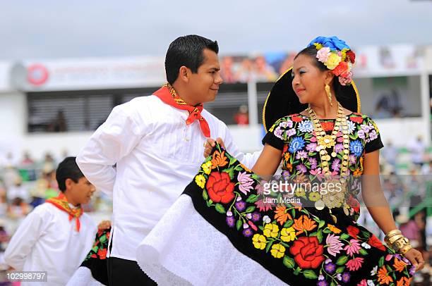 Tehuanas of Juchitan of Zaragoza perform during the Guelaguetza of Bicentenary at the Benito Juarez Stadium on July 19 2010 in Oaxaca City Mexico