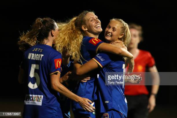 Teigan Collister of the Newcastle Jets celebrates a goal with team mate Tara Andrews during the round 14 W-League match between the Newcastle Jets...