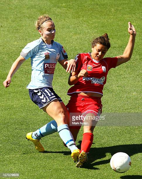 Teigen Allen of Sydney and Ruth Wallace of Adelaide contest possession during the round three WLeague match between Sydney FC and Adelaide United at...