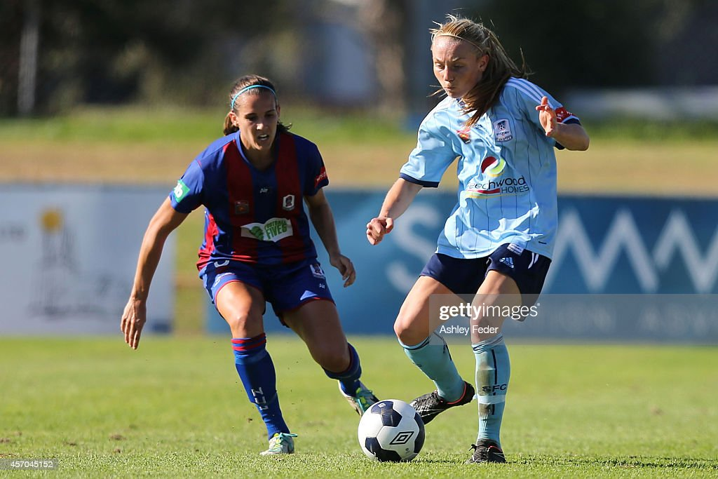 Teigen Allen of Sydney FC contests the ball against Katherine Reynolds of the Jets during the round five W-League match between the Newcastle Jets and Sydney FC at Magic Park on October 11, 2014 in Newcastle, Australia.