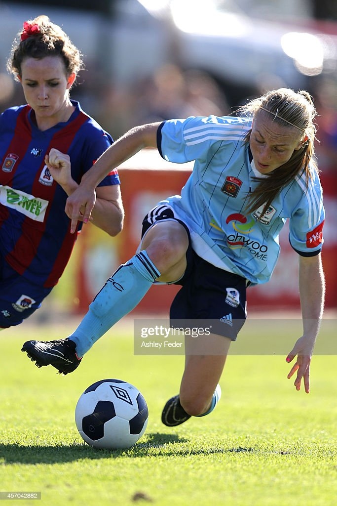 Teigen Allen of Sydney FC contests the ball against Rhali Dobson of the Jets during the round five W-League match between the Newcastle Jets and Sydney FC at Magic Park on October 11, 2014 in Newcastle, Australia.