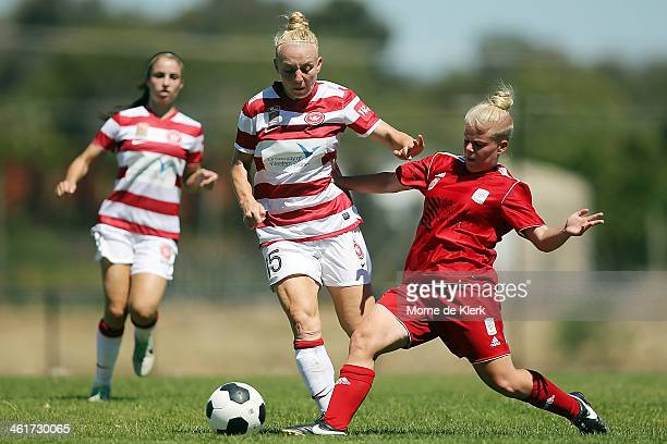 Teigen Allen of the Wanderers is tackled by Jessica Waterhouse of Adelaide during the round 8 WLeague match between Adelaide United and the Western...