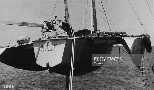 Teignmouth Electron the trimaran belonging to British yachtsman Donald Crowhurst is hoisted aboard the British ship Picardy after being found found...