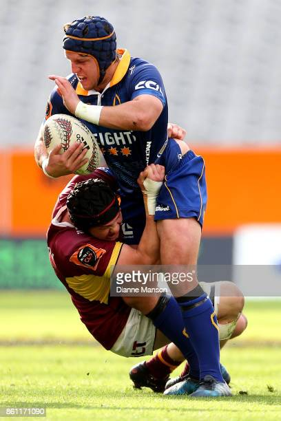 Teihorangi Walden of Otago is tackled by Phil Halder of Southland during the round nine Mitre 10 Cup match between Otago and Southland at Forsyth...