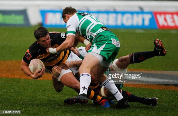 Teihorangi Walden of Taranaki is tackled during the round 2 Mitre 10 Cup match between Manawatu and Taranaki at Central Energy Trust Arena on August...