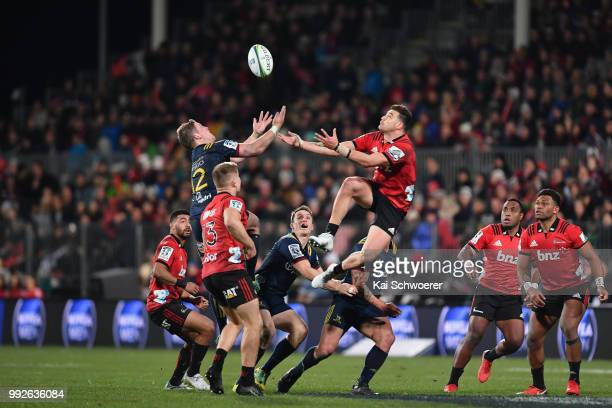 Teihorangi Walden of the Highlanders and David Havili of the Crusaders compete for the ball during the round 18 Super Rugby match between the...