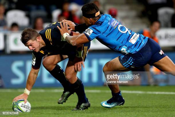 Teihorangi Walden of the Highlanders dives over to score a try in the tackle of Augustine Pulu of the Blues during the round two Super Rugby match...