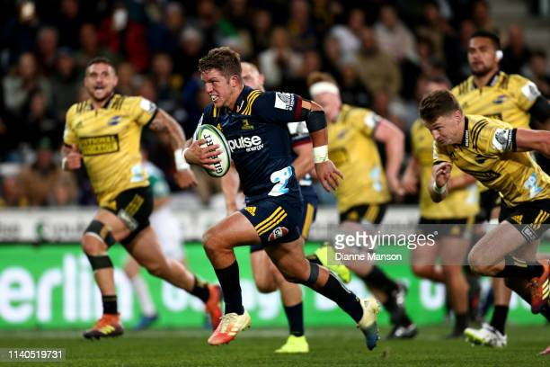 Teihorangi Walden of the Highlanders makes a break during the round 8 Super Rugby match between the Highlanders and Hurricanes at Forsyth Barr...