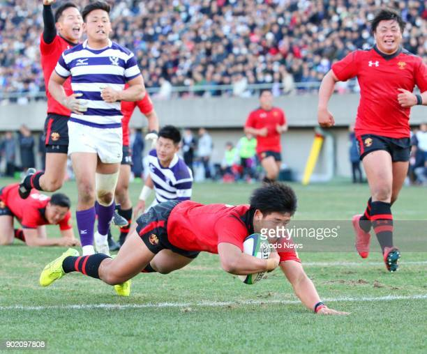 Teikyo University's Yuki Okada scores a try in the second half of a 2120 win over Meiji University in the collegiate rugby championship final at...