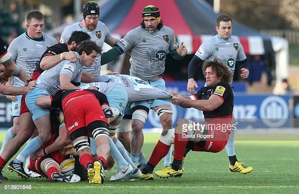 Teimana Harrison of Northampton is pulled by Jacques Burger during the Aviva Premiership match between Saracens and Northampton Saints at Allianz...