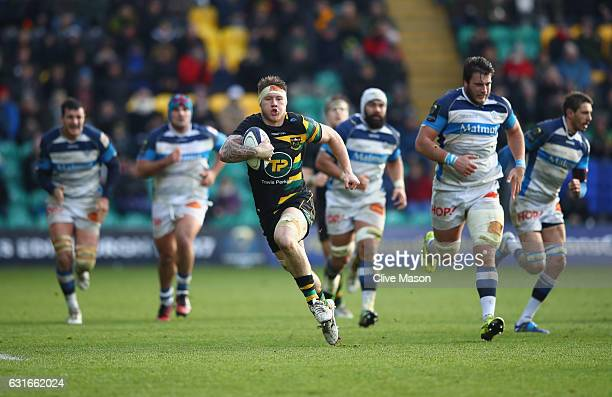 Teimana Harrison of Northampton is tackled by Julien Dumora of Castres during the European Rugby Champions Cup match between Northampton Saints and...