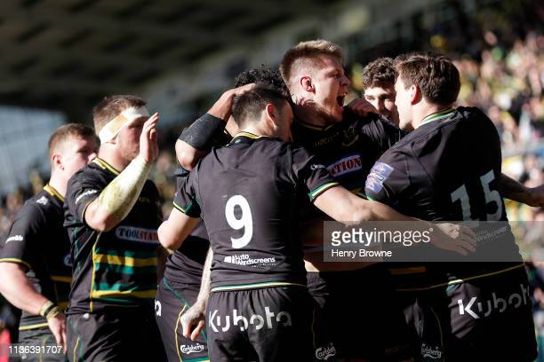 Teimana Harrison of Northampton Saints celebrates scoring their first try during the Premiership Rugby Cup Final match between Northampton Saints and...