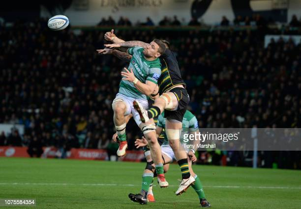 Teimana Harrison of Northampton Saints challenges Mark Wilson of Newcastle Falcons during the Gallagher Premiership Rugby match between Northampton...