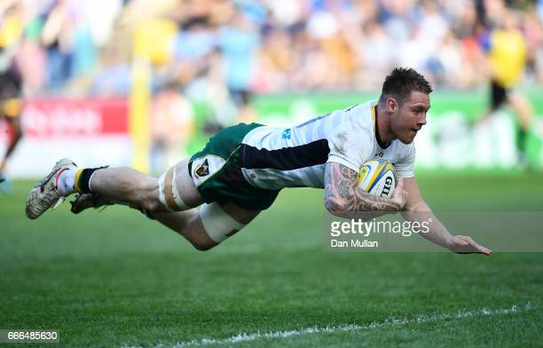 Teimana Harrison of Northampton Saints dives over to score his side's fifth try during the Aviva Premiership match between Wasps and Northampton...