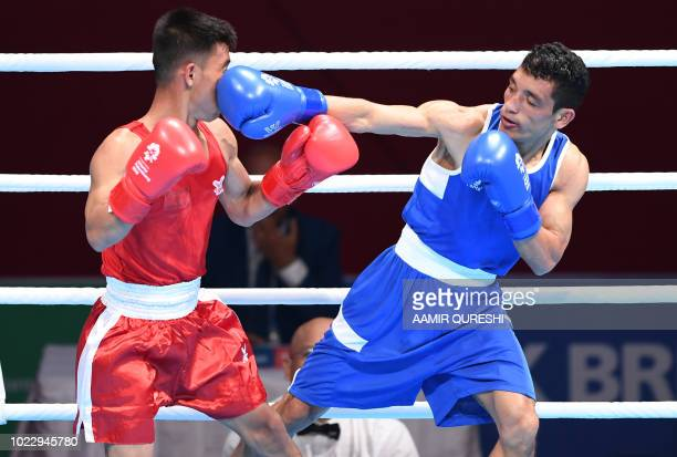 Teja Bahadur Deuba of Nepal competes against Khamphouvanh Khamsathone of Laos during the men's light fly 49kg boxing round of 32 at the 2018 Asian...