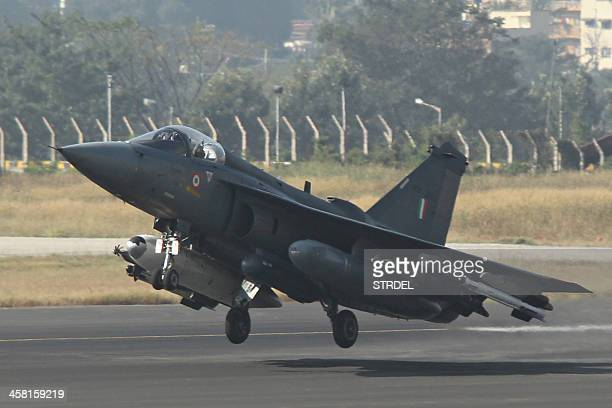 Tejas multirole light combat aircraft takes off for the type's initial operational clearance for induction into the Indian Air Force in Bangalore on...