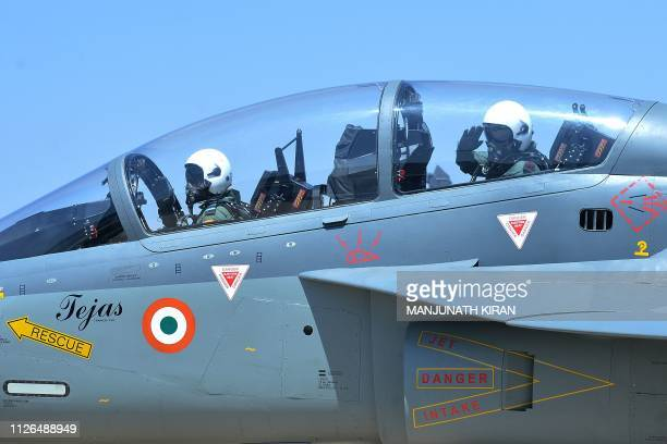 Tejas pilot N Tiwari taxis towards the runway to take off as the 27th Chief of Army Staff of the Indian Army Bipin Rawat salutes during the Aero...