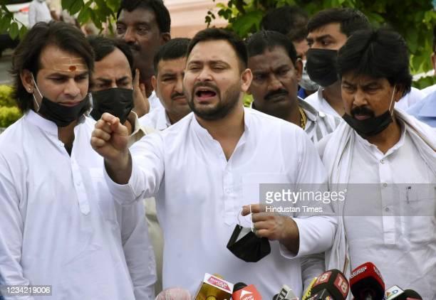 Tejashwi Yadav along with party legislators speak to the media outside on July 26, 2021 in Patna, India.