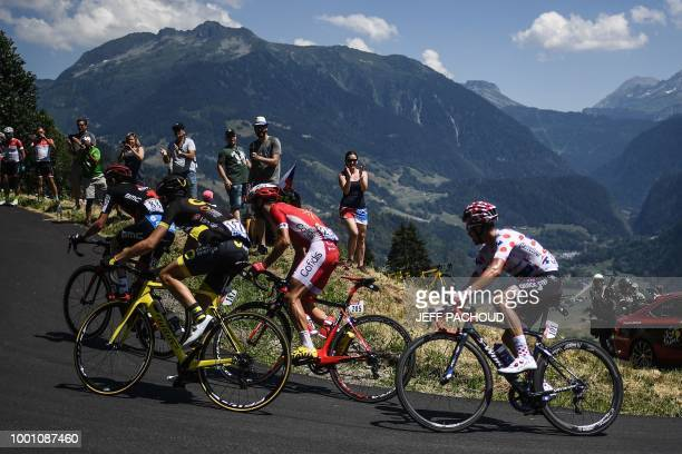 This combination of photos taken during the eleventh stage of the 105th edition of the Tour de France cycling race between Albertville and La Rosiere...