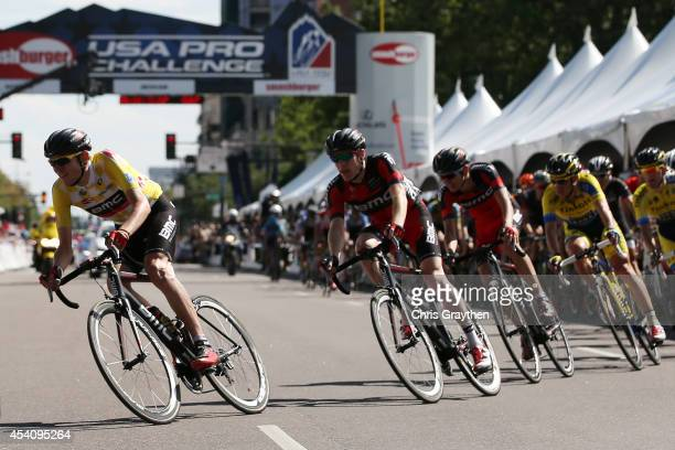 Tejay van Garderen of the United States riding for the BMC Racing Team in the yellow leader's jersey rides in the peloton during the final stage of...