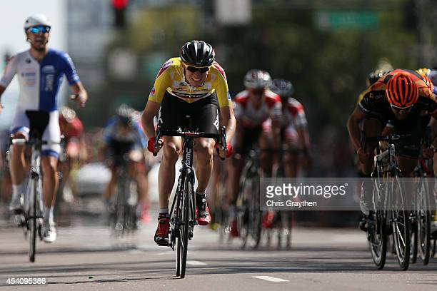 Tejay van Garderen of the United States riding for the BMC Racing Team in the yellow leader's jersey sprints to the finish line at the end of the...