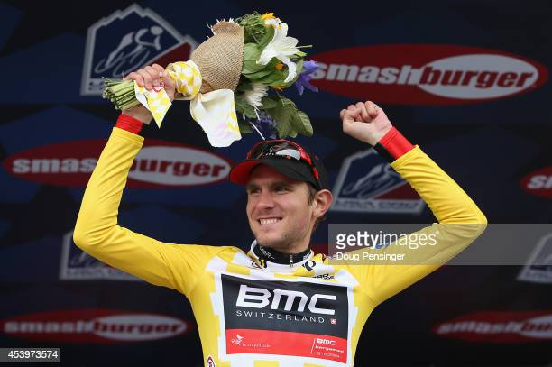 Tejay van Garderen of the United States riding for the BMC Racing Team celebrates on the podium as he defended the overall race leader's yellow...