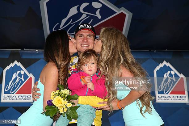 Tejay van Garderen of the United States riding for the BMC Racing Team celebrates in the yellow leader's jersey after winning the individual time...