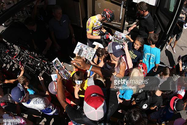 Tejay van Garderen of the United States riding for the BMC Racing Team signs autographs for fans before the final stage of the 2014 USA Pro Challenge...