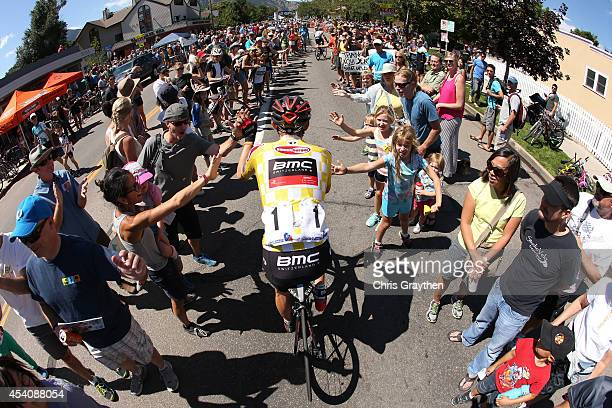 Tejay van Garderen of the United States riding for the BMC Racing Team rides to the start line before the final stage of the 2014 USA Pro Challenge...