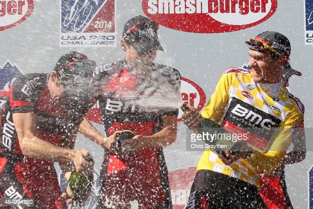 Tejay van Garderen of the United States riding for the BMC Racing Team celebrates in the yellow leader's jersey celebrates with his team on the...