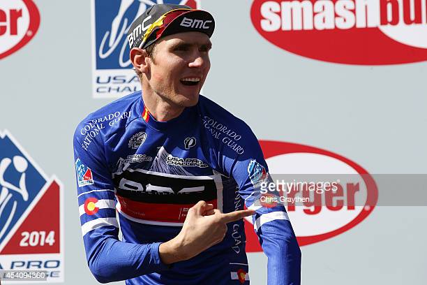 Tejay van Garderen of the United States riding for the BMC Racing Team points to the Colorado flag on the jersey for the best placed Colorado rider...