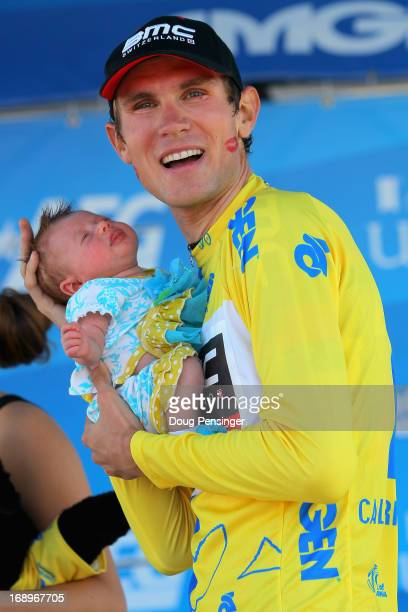 Tejay van Garderen of the USA riding for BMC Racing takes the podium with his daughter Rylan after winning the Individual Time Trial during Stage Six...