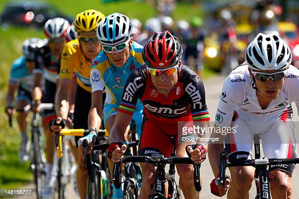 Tejay Van Garderen of the USA riding for BMC Racing works for team leader Cadel Evan of Australia riding for BMC Racing as Janez Brajkovic of...