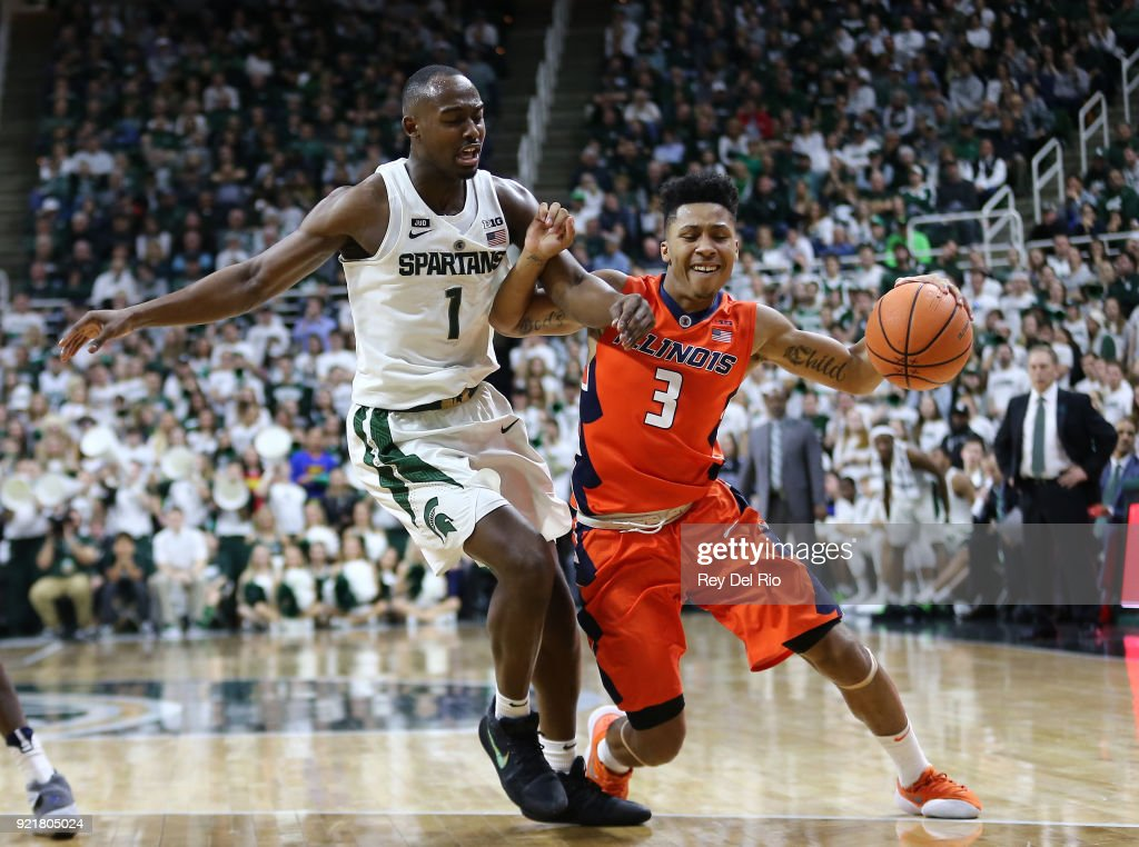 Te'Jon Lucas #3 of the Illinois Fighting Illini drives to the basket and draws a foul from Joshua Langford #1 of the Michigan State Spartans at Breslin Center on February 20, 2018 in East Lansing, Michigan.