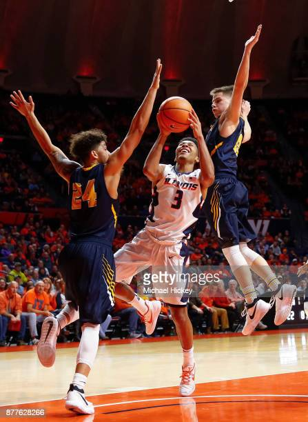 Te'Jon Lucas of the Illinois Fighting Illini shoots the ball against Pierson Wofford of the AugustanaIllinois Vikings at State Farm Center on...