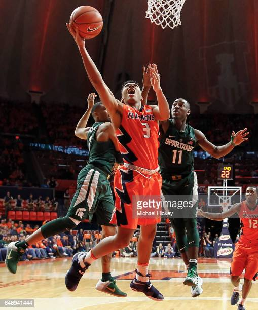 Te'Jon Lucas of the Illinois Fighting Illini shoots the ball between Alvin Ellis III and Lourawls Nairn Jr #11 of the Michigan State Spartans at...