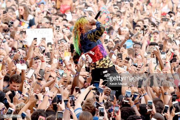 Tekashi 6ix9ine performs in the crowd during the 2018 Made In America Festival Day 1 at Benjamin Franklin Parkway on September 1 2018 in Philadelphia...