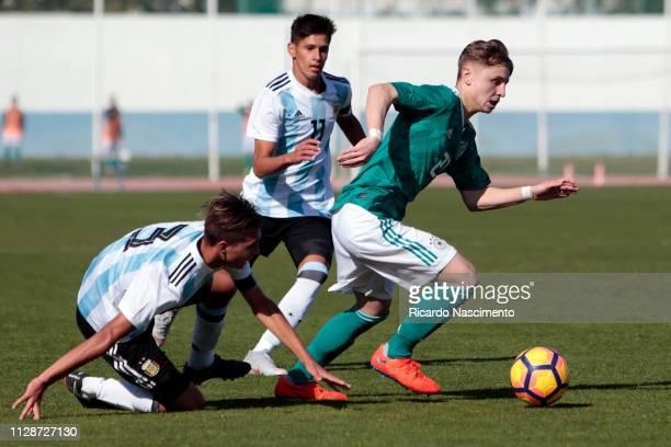 Tekin Gencoglu of Germany U16 challenges Julian Aude an dBrian Nicolas Aguirre of Argentina U16 during UEFA Development Tournament match between U16...