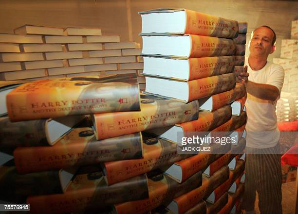 A worker prepares copies of the seventh and final book by JK Rowling entitled Harry Potter and the Deathly Hallows 20 July 2007 at a book store in...