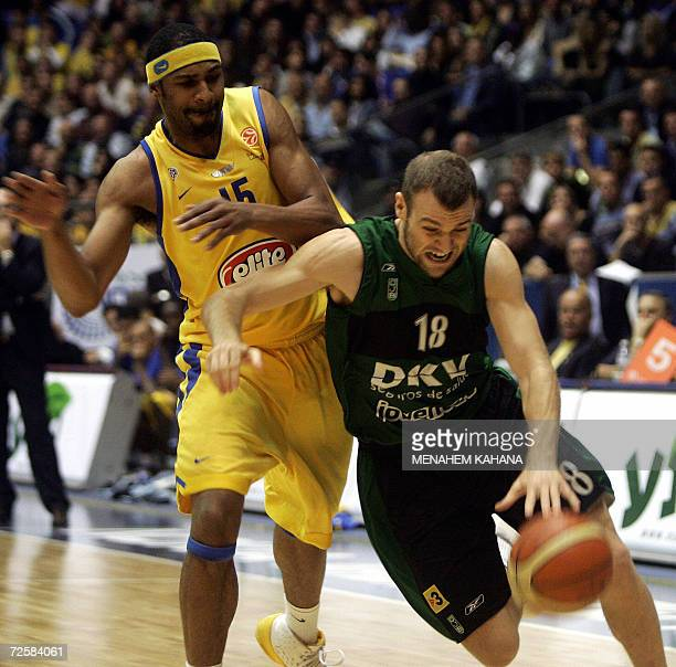 Spain's DKV Joventut Badalona player Ferran Lavina vies with Maccabi Elite Tel Aviv's Rodney Buford during their Euroleague basketball Group B match...