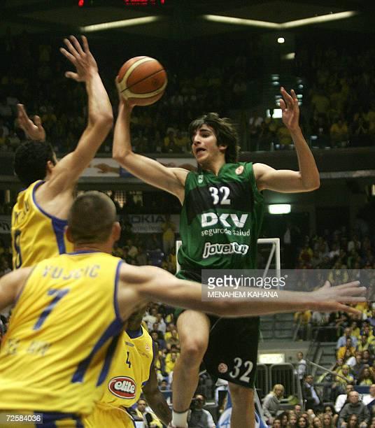 Spain's DKV Joventut Badalona Ricky Rubio goes to the basket as Maccabi Elite Tel Aviv's Nikola Vujcic and Lior Eliyahu try to block him during their...