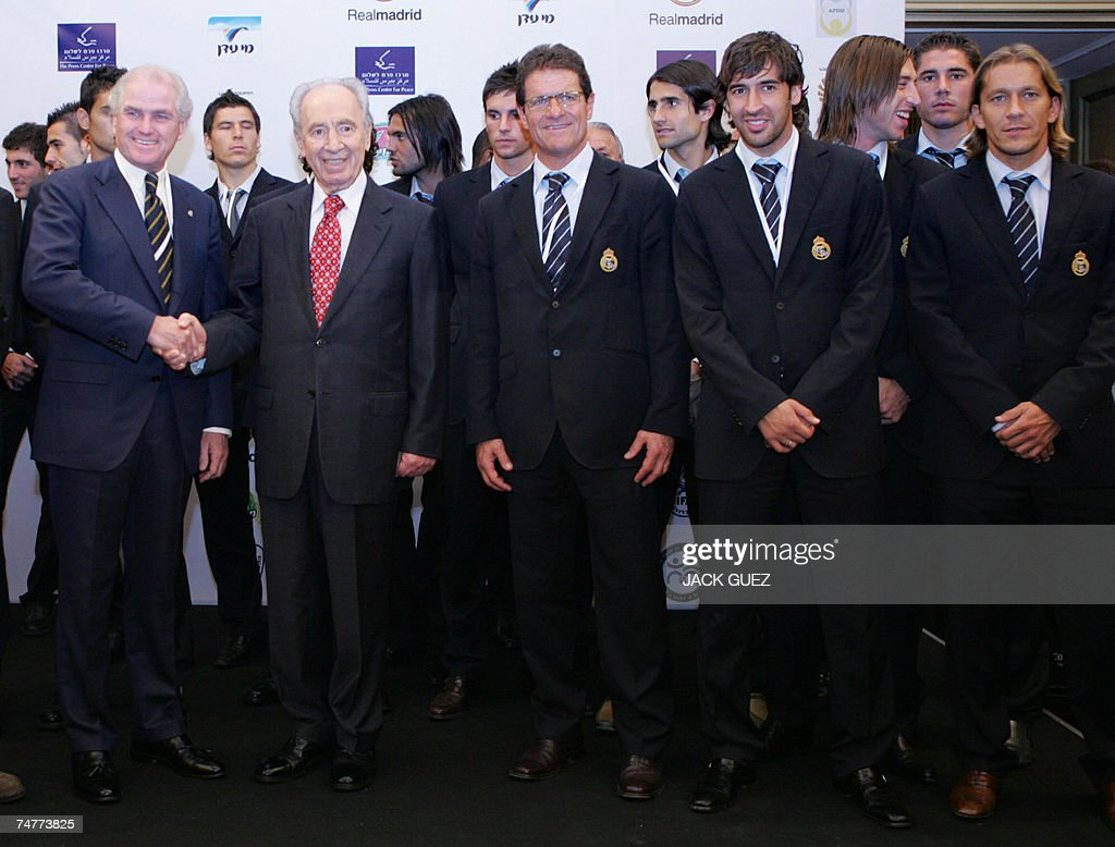 Spanish Real Madrid soccer team President Ramon Calderon (L) shakes hands with newly elected Israeli President Shimon Peres (2nd-L) as he stands next to coach Fabio Capello ( 3rd-L), Real Madrid's team captain Raul Bravo and Michel Salgado (R) in Tel Aviv prior to tonight's 'Peace Match' hosted by the Peres Center for Peace, 19 June 2007. The Peres Center's 'Peace Team', comprised of both Palestinian and Israeli players will play against Real Madrid tonight at the Ramat Gan Stadium, near Tel Aviv.