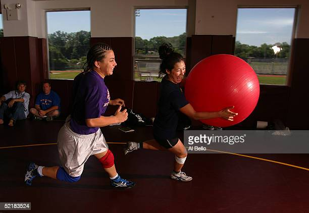 Tela O'Donnell and Stephany Lee of the US Olympic women's wrestling team play their version of dodge ball with their training partners at their...