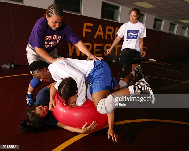 Tela O'Donnell and Toccara Montgomery of the US Olympic women's wrestling team play their version of dodge ball with their training partners at their...