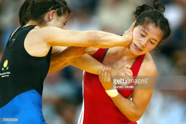 Tela O'Donnell gets checked by Stephanie Murata in the Women's Semi-Finals during the 2004 U.S. Olympic Team Trials of Wrestling at the RCA Dome on...