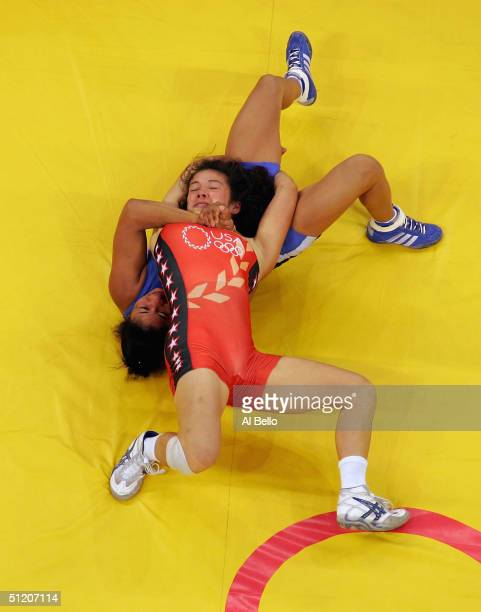 Tela O'Donnell of the USA locks up with Mabel Foneseca of Puerto Rico during the women's Freestyle wrestling 55 kg qualification round on August 23,...