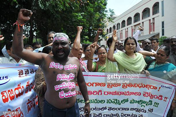 Telangana Joint Action Committee actvist T Veera Swamy and other demonstrators shout slogans in support of the separate state of Telangana in...